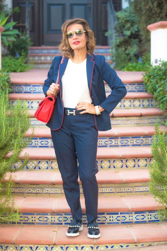 Sandro Pants and Jacket; Rag and Bone T-Shirt; Robert Clergerie Shoes; Hermes Belt; Chanel Handbag, Cuff, and Sunglasses; Christian Dior Earrings.
