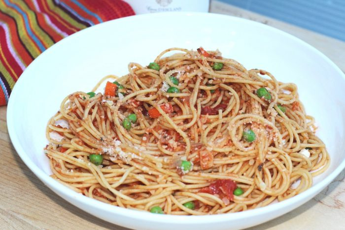 Capellini with Tomato and Peas Recipe.