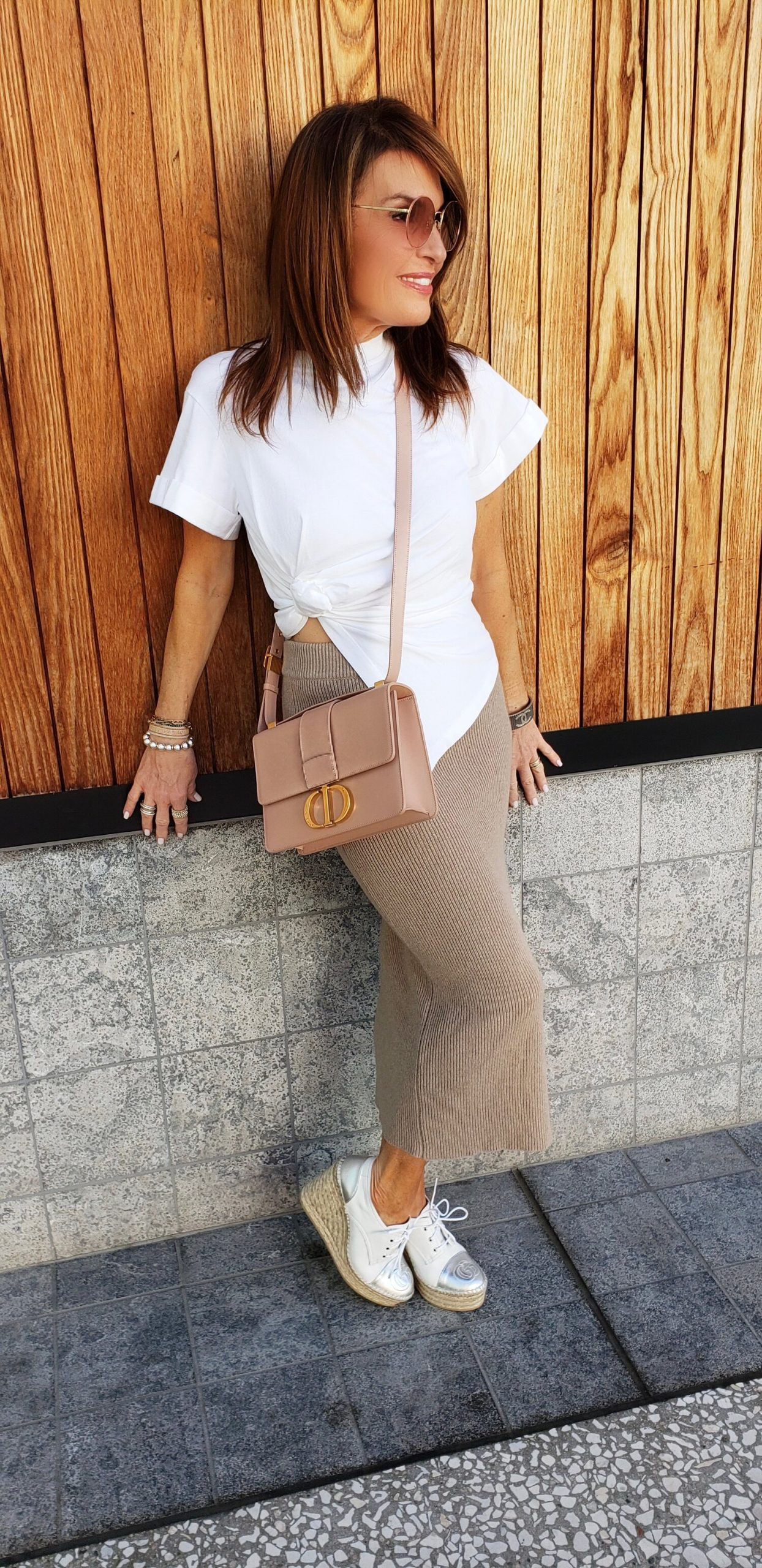 A Long Knit Skirt and Short White Tee.
