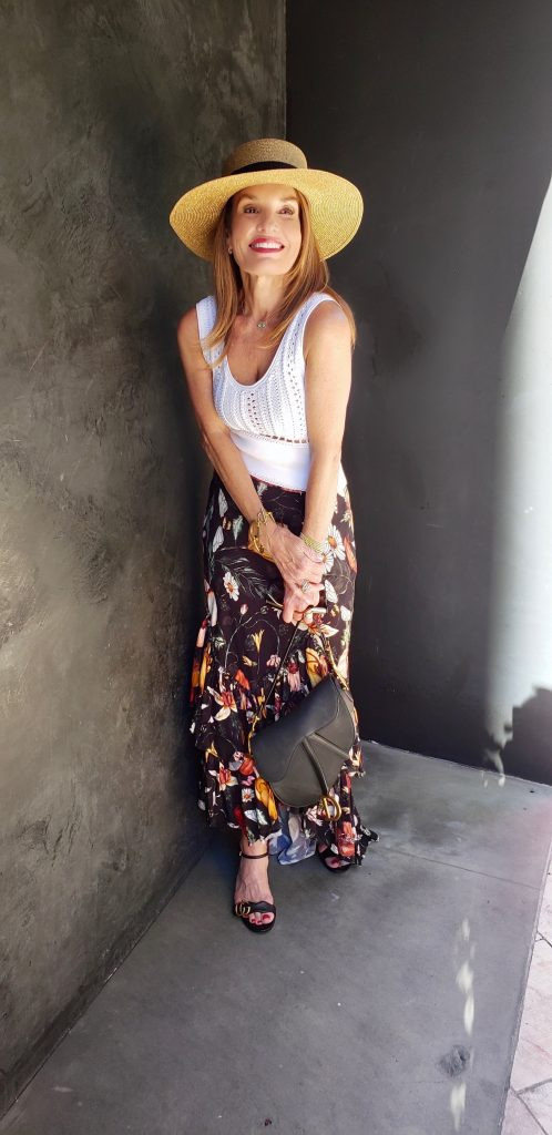 Philip Lim Top, Atelier 17-56 Skirt, Gucci Hat, Bottega Veneta Sunglasses, Gucci Sandals, Dior Handbag, Oscar De La Renta Chain Bracelet (Right Arm), Jewels By Molly Sydney Stretch Bracelets (Left Arm).